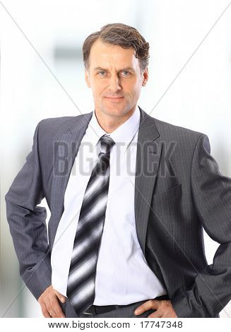 Closeup portrait of a happy mature business man smiling - Copyspace
