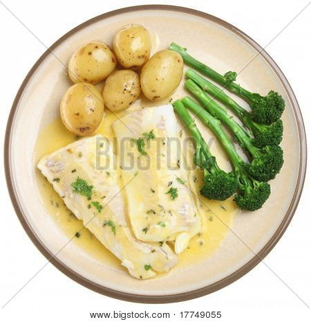 Haddock fillets in a herb and lemon sauce with vegetables.