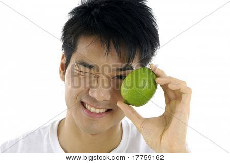 Young man holding fresh lemon