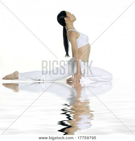 Reflection for beautiful young woman practicing yoga
