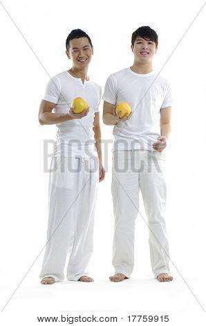 Asian young man holding grapefruit