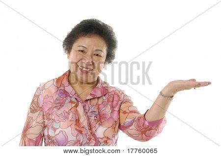 senior lady presenting something isolated on white
