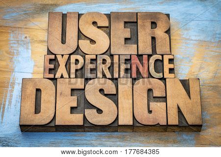 user experience design - word abstract in vintage letterpress wood type against grunge wooden background