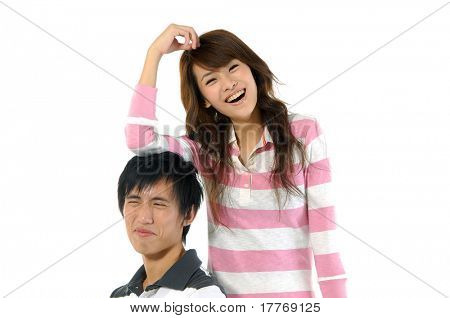 Young couple standing together smiling