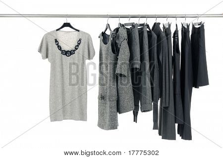 Designer fashion clothing hanging as display