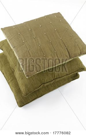 Three pillows stacked on white background