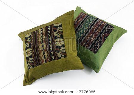 Three pillows stacked on white background