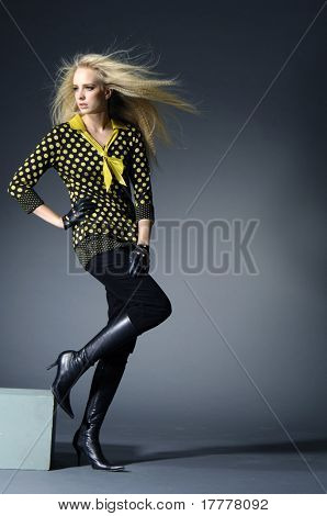 attractive fashion model with long hair on light background