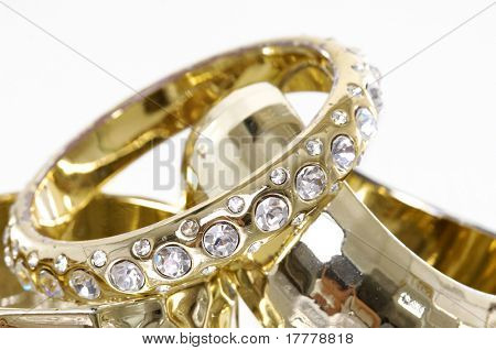 golden bracelets isolated on white