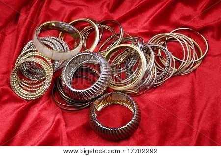 Fashion bracelets crafted on red background