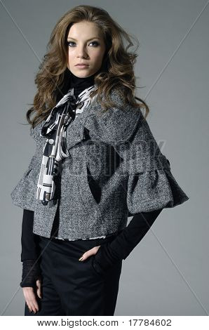 Attractive young fashion model on grey