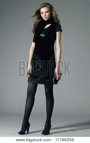 fashion model holding little purse shot in studio
