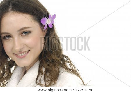 Beautiful smile girl with orchid flower.