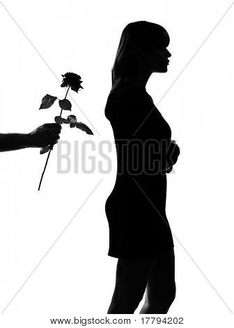 man hand offering a flower rose stylish sexy silhouette caucasian beautiful woman on studio isolated white background