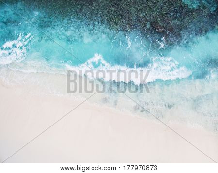 poster of Beautiful tropical white empty beach and sea waves seen from above. Seychelles Grand Anse beach aeri