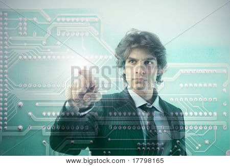 Young businessman touching a microchip