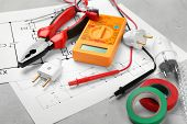 Electrician tools and schemes on grey background poster