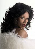 stock photo of drag-queen  - drag artist with white fur - JPG