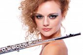 stock photo of transverse  - Portrait of a woman playing transverse flute - JPG