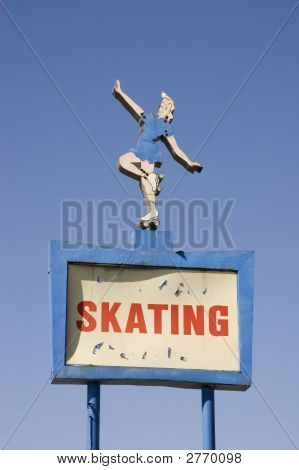 Pigeon On Top Of Roller Skating Rink Sign