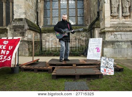Billy Bragg Performing In Front Of Exeter Cathedral As Part Of An Afternoon Of Music And Performace