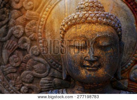 Rock Buddha Statue With Sunlight