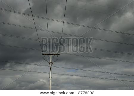 Power Lines And Cloudy Sky