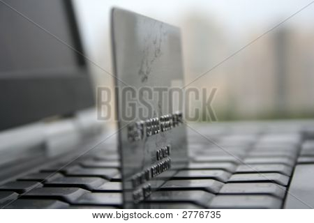 A Shot Of A Laptop And A Credit Card In An Office Environment, Can Be Used As E-Commerce Concept