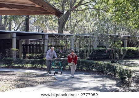 Elderly Couple Walking  Walker