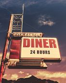 Retro Vintage Image Of Old Motel And Diner Sign In Small Town Usa poster