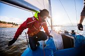 Beautiful Inspiring Shot Of Action Adventure Of Sailor Or Captain On Yacht Or Sailboat Attaching Big poster