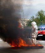 Fiteman In A Fire Proximity Suit Puts On Fire.fireman In A Fire Proximity Suit Which Made To Protect poster