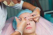 Doctor Giving Face Lifting Injection On Mid Age Woman In The Forehead Between Eyebrows To Remove Exp poster