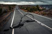 Damaged asphalt road (Crater Rim Drive) in the Hawaii Volcanoes National Park after earthquake and e poster