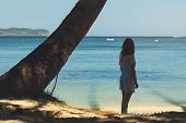 Beautiful Woman Standing Under Palm Tree On The Beach. Healthy People Lifestyle. Woman Relaxing On T poster