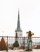 Woman Sightseeing In Tallinn City Europe Vacations In Estonia Travel Lifestyle Girl Tourist At Viewp poster