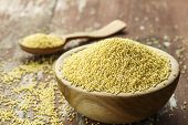 Raw Millet Groats In A Wooden Plate On A Shabby Wooden Background. Space For Text poster
