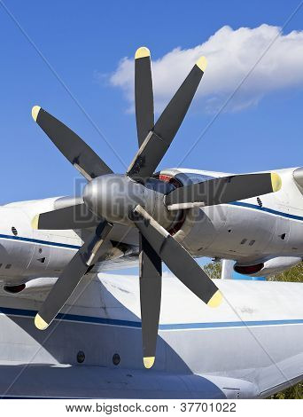 Turboprop Transport Aircraft Against The Blue Sky Closeup