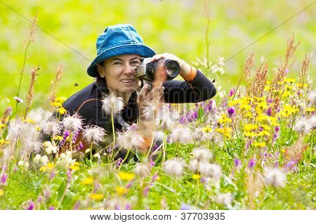 Woman Hiker Makes Photo Of The Landscape In The Mountins