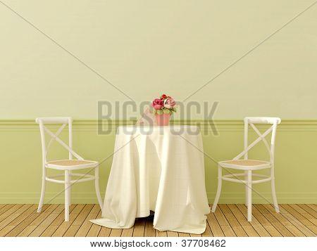 Dos sillas con una mesa de café
