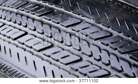 Close Up Wet Worn Tire Grooves