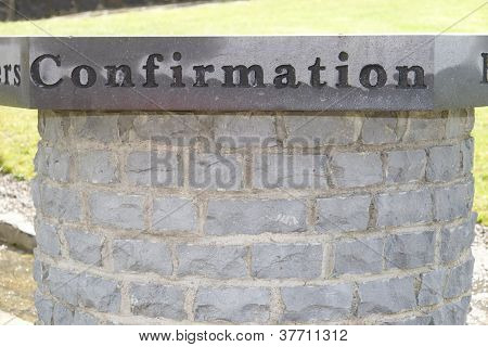 Confirmation Inscribed On A Granite Table