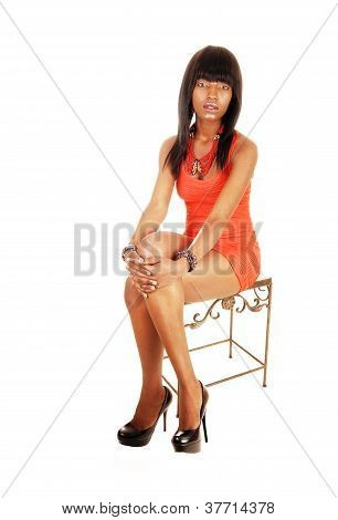 Young Black Woman Sitting.