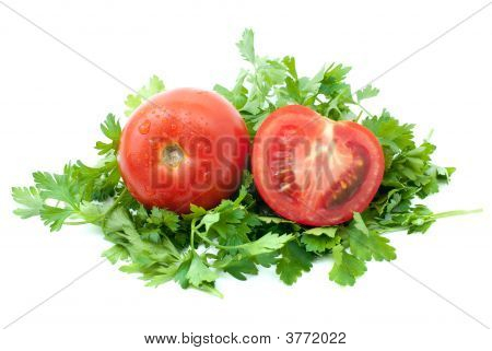 Ripe Red Tomato And Half With Some Parsley