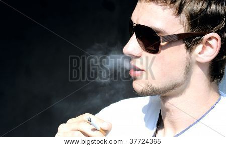 Smoker in sunglasses