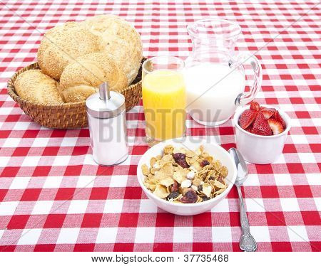 Breakfast Of Cereal, Fruit, Rolls, Orange Juice And Milk