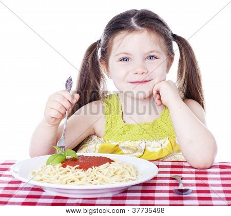 Beautiful Girl Eating A Bowl Of Pasta With Sauce