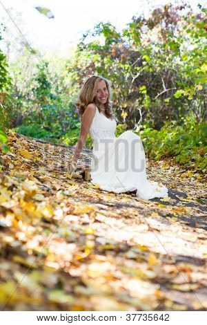 Happy Bride In White Dress On Autumn Sunny Nature