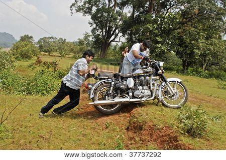 Bikers Push Motorbike Over Garden Ridge