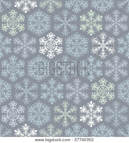 Christmas seamless pattern with snoflakes in retro style.